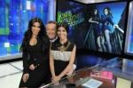 Kim and Khloe Kardashian sit on Piers Morgan's lap for a CNN News promotion